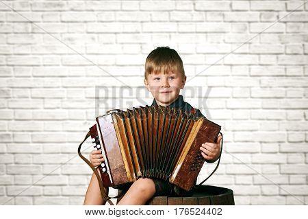 Little boy with the accordion .Preschool education