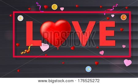 Love typography, large red heart in the form of an inflatable, scarlet balloon. Top view, composition with candles, tinsel and confetti on black wooden background. Template for creative persons
