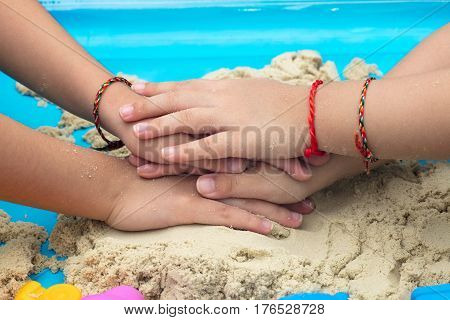 Childs Hand Close Up Playing Kinetic Sand