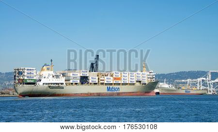 Oakland CA - March 14 2017: Cargo ship KAUAI entering the Port of Oakland. Matson provides shipping services Pacific wide. Mainly to and from the Hawaiian Islands.