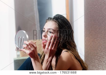 Pretty Girl Looking At Makeup Mirror