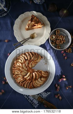 The delicious apple pie with walnuts an a blue apple pie