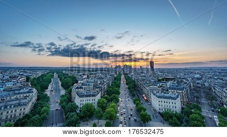Wide angle skyline of Paris with la defense at sunset