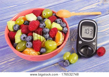 Fresh Fruit Salad And Glucometer, Diabetes, Healthy Lifestyle And Nutrition Concept