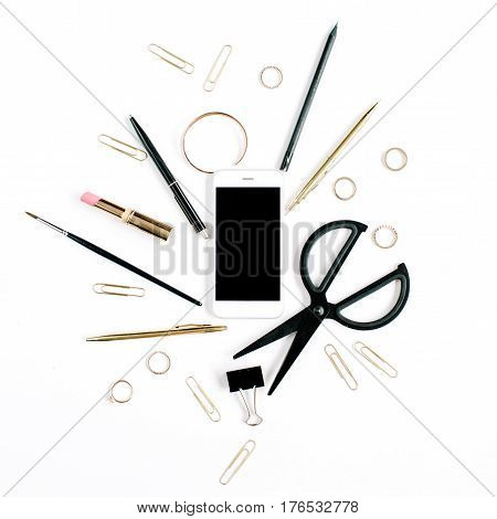 Home office workspace with mobile phone scissors clips and female accessories. Flat lay top view