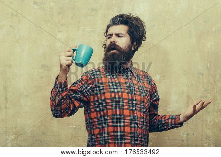 Singing Bearded Man Pulling Stylish Fringe Hair With Blue Cup