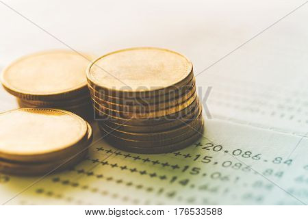 pile of gold coins on bank account finance and banking concept