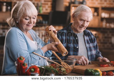 Portrait Of Senior Couple Cooking Together At Home