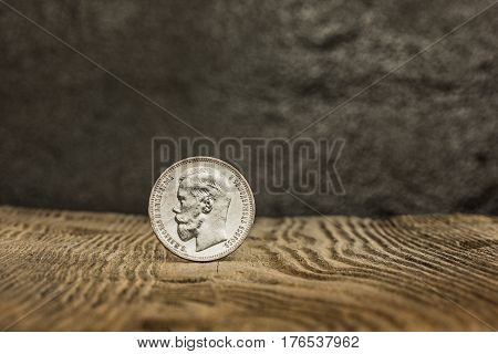 Closeup of old russian coin on a wooden table background.