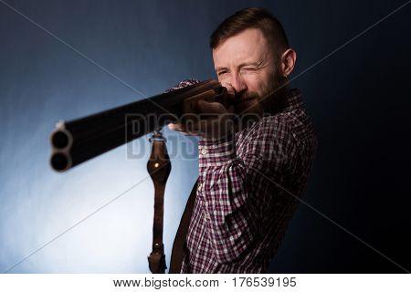 Man With Shotgun On A Dark Background