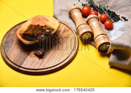 Calzone Or Pie With Vegetables, Pepperbox And Saltcellar On Tray