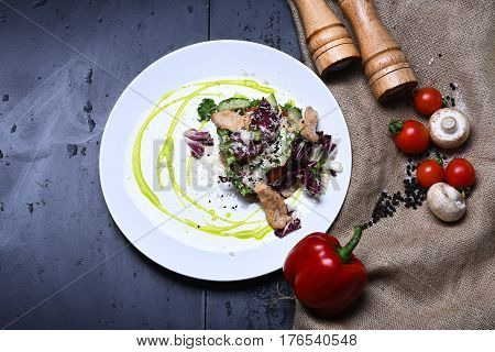Cooked Fish With Fresh Salad Leaves And Vegetables On Burlap