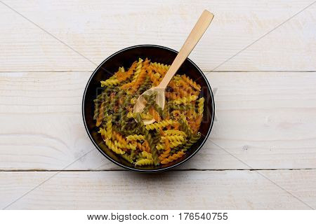 Colorful Fusilli Pasta On Wooden Background