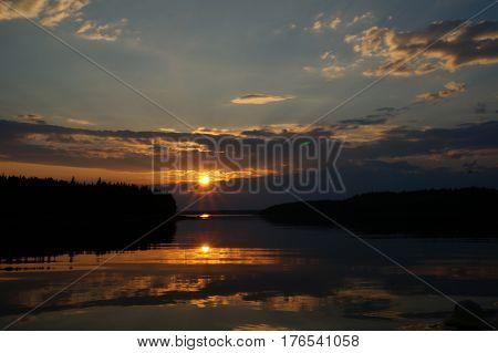 Photography of boat floating across lake at sunset
