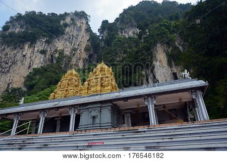 Kuala Lumpur Malaysia - November 3 2014: One of the Hindu temples in the territory of Batu Caves. Batu Caves - a complex of cave hills and Hindu shrines at a distance of 13 km from the center of Kuala Lumpur.