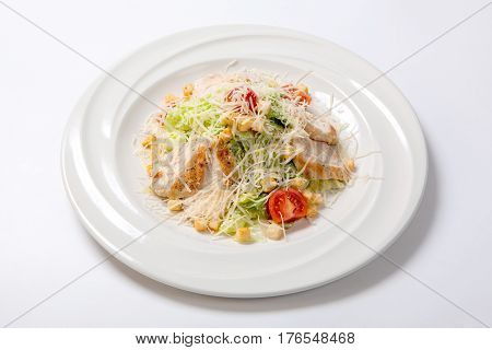Caesar Salad With Chicken On A White Round Plate