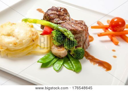 Medallions Of Grilled Veal With Potatoes And Broccoli.