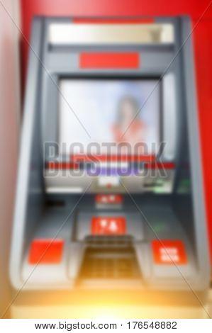 Photo of red cash dispenser inside room