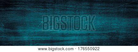 Dark blue wooden texture. Empty horizontal long banner format. Wooden background.