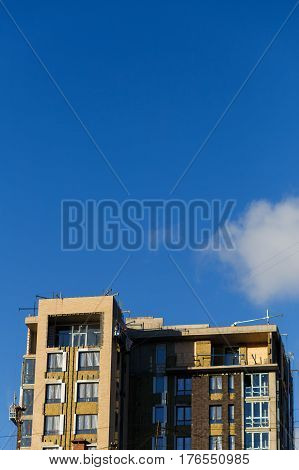 Photo of building with windows on background of blue sky