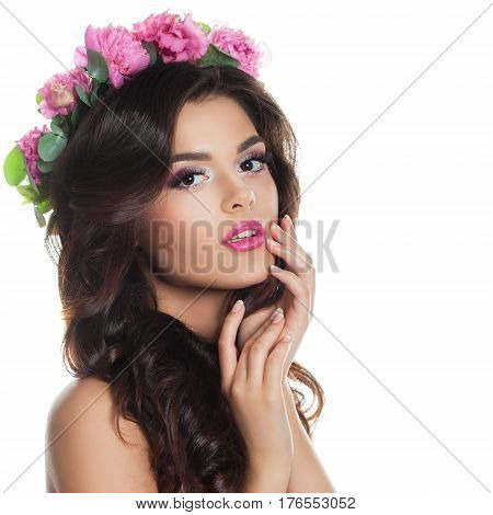Fashion Model with Makeup Prom Hairstyle and Spring Flowers Wreath Isolated on White. Young Beautiful Woman