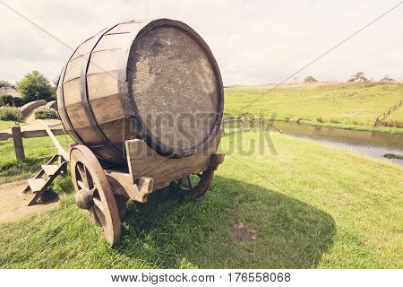 Old traditional drink wagon in the meadow. (Springy textured)