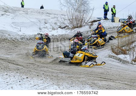 Tyumen Russia - March 08. 2008: IV stage of personal-team Championship of Ural Federal district in over-snow cross-country. Snowmobiles moves on bend of sport track
