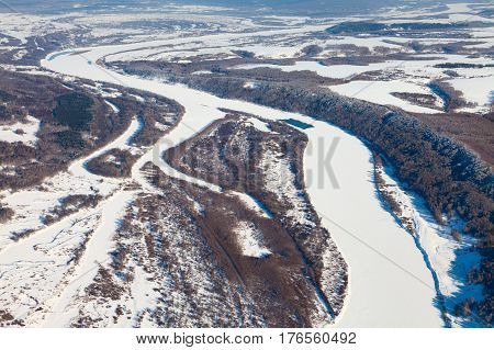 Aerial view from above Oka river during cold winter day.