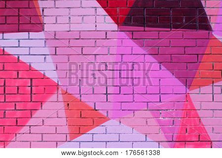 Colorful (pink purple coral and burgundy) painted brick wall as background texture