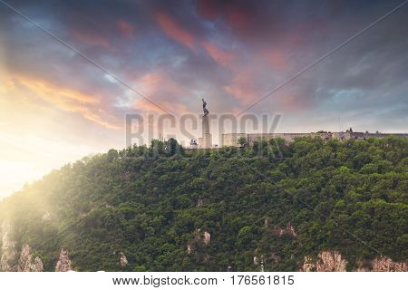 Statue of Liberty, Gellert hill, Budapest, Hungary. Panorama of the city with a statue on the horizon