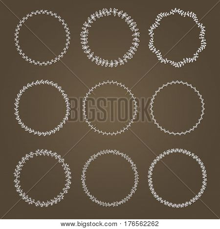 Set wreaths. Decorative wreaths plant motifs. It contains nine different wreaths. Brown background.