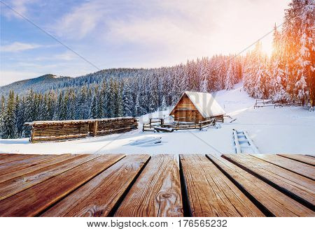 Winter Mountains Landscape With A Snowy Forest And  Wooden Hut