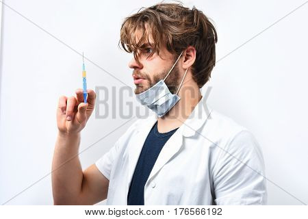 Bearded Caucasian Doctor Or Postgraduate Student With Syringe In Mask