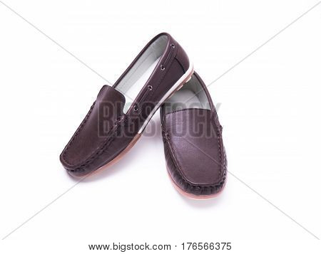Brown moccasins for a boy on a white isolated background