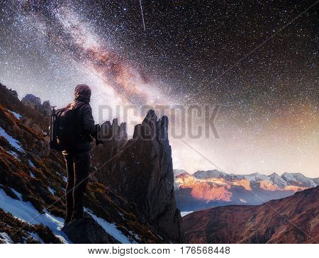 Landscape With Milky Way, Night Sky  Stars And Silhouette Of A Standing Photographer Man On The Moun