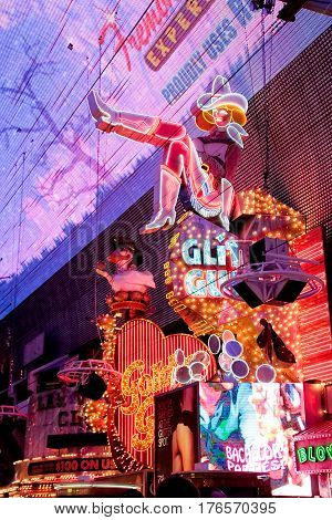 LAS VEGAS, US - OCTOBER 28: Cowgirl neon sign on October 28, 2015 in Las Vegas, US. The iconic sign of Glitter Gulch is placed in 20 East Fremont Street, in Downtown Las Vegas