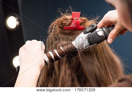 Hairstylist Curling Hair