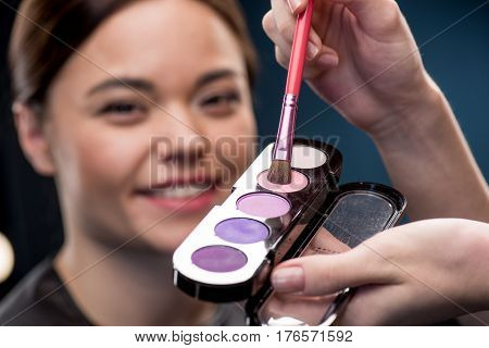 Woman Picking Up Color Of Eyeshadows
