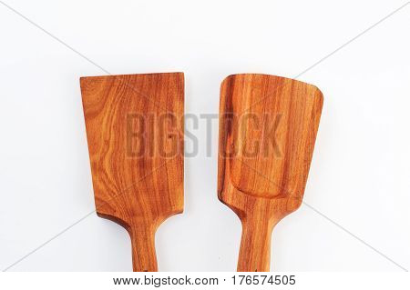 Old wooden spoons and stirrers on white background. Isolated