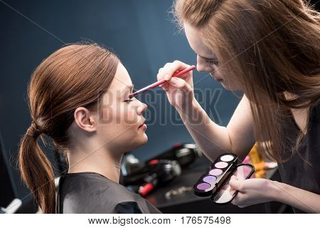 Make-up Artist Applying Eyeshadow