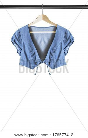 Blue denim crop jacket on wooden clothes rack isolated over white