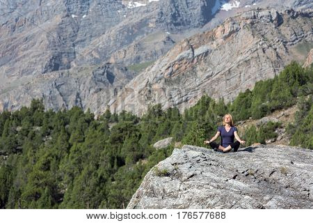 Mountain and Forest View and Woman doing Yoga Ex