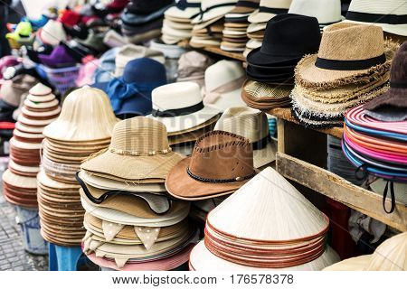 Variety of men and women hats at street market