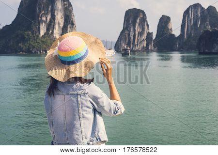 Woman traveler looking beautiful natural view at Halong bay in Vietnam