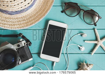 Overhead view of Traveler's accessories items and cellphone with copy space, Travel concept