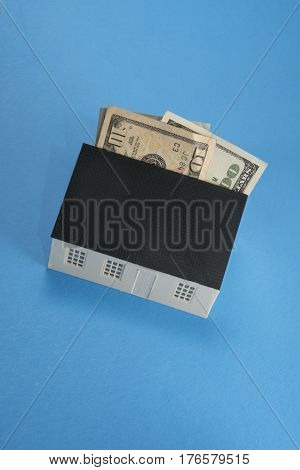 Home expense illustrated with money coming out of a house