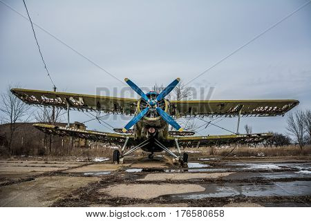 HDR foto of an old airplane on airfield and cloudy background