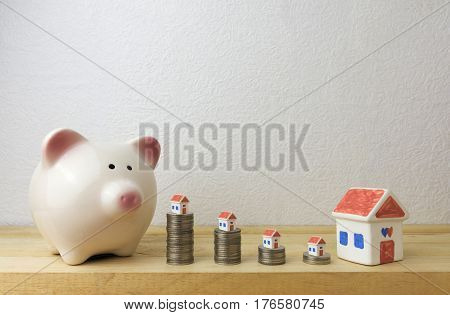 piggy bank with house and coins for money concept