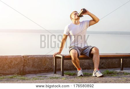 Young Man Drinks A Protein Cocktail