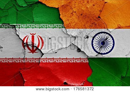 Flags Of Iran And India Painted On Cracked Wall
